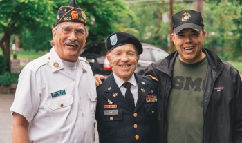 three veterans smiling with their arms around each other_thumbnail Benefits of Blogging